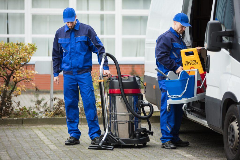 Cleaning Crew unloading equipment from van